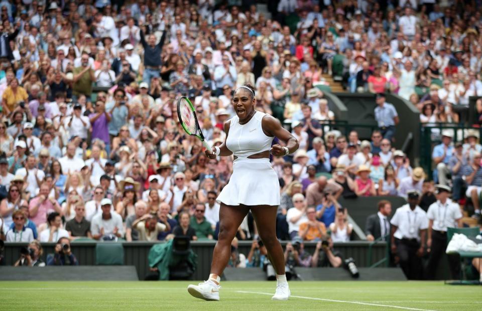 Serena Williams celebrates after winning her quarter-final  match against Alison Riske of the U.S.