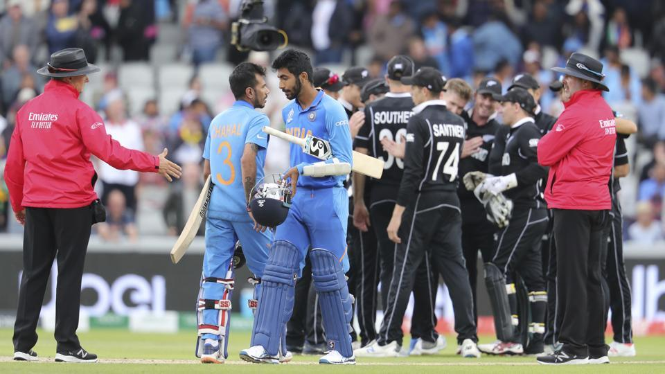 India's Yuzvendra Chahal, left in blue, and India's Jasprit Bumrah react. (AP)
