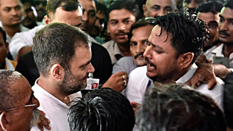 Congress leader Rahul Gandhi listens to a man during his visit at Gauriganj in Amethi on Wednesday.