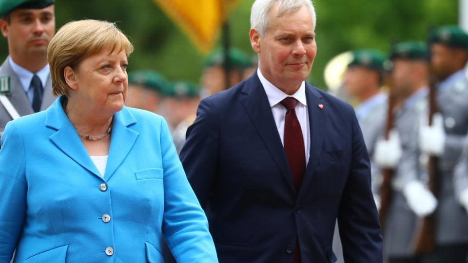 German Chancellor Angela Merkel receives Finland's new Social Democrat Prime Minister Antti Rinne with military honours at the Chancellery in Berlin, Germany, July 10, 2019. REUTERS/Hannibal Hanschke