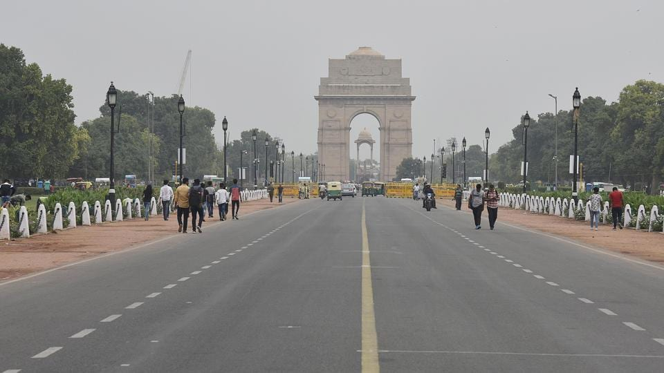 Back in Delhi at India Gate and its surrounding lawns, heavy tourist footfall is a daily occurrence as the weather turns more tolerable. The British-era monument is illuminated every evening and is a major tourist attraction well into the night. Few people or vehicles around the monument made for a rare sight as cricket trumped sightseeing. (Biplov Bhuyan  / HT Photo)