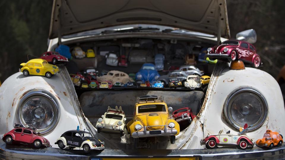 """A collection of beetle car toys is seen on a Volkswagen Beetle displayed during the annual gathering of the """"Beetle Club"""" in Yakum, central Israel, on April 21, 2017. Volkswagen is halting production of the last version of its Beetle model in July 2019 at its plant in Puebla, Mexico, the end of the road for a vehicle that has symbolized many things over a history spanning eight decades since 1938. (Oded Balilty / AP)"""