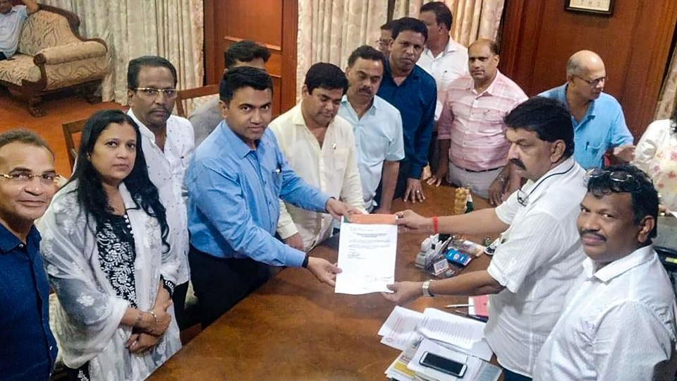 Ten of 15 Congress members led by leader of opposition Chandrakant Kavlekar gives letter for merger of their faction in BJP to Speaker Rajesh Patnekar, in Panaji, on July 10, 2019