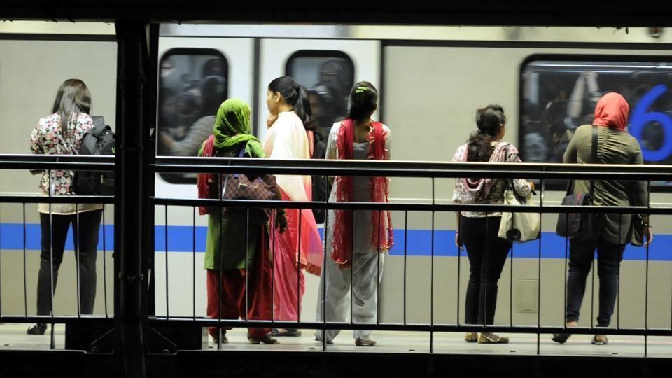 Women waiting Metro train arrive their destination.