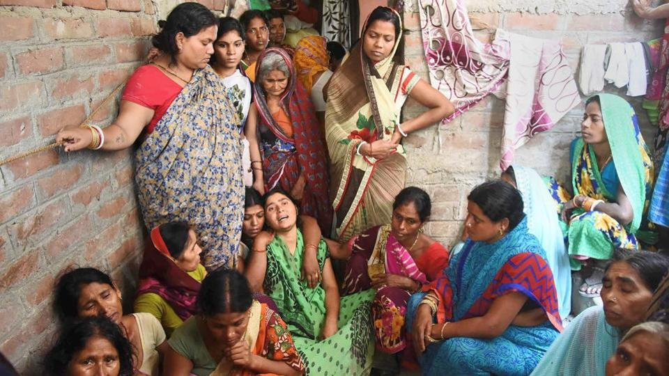 Family members and relatives mourn the death of a kin who died in a wall collapse in Patna.
