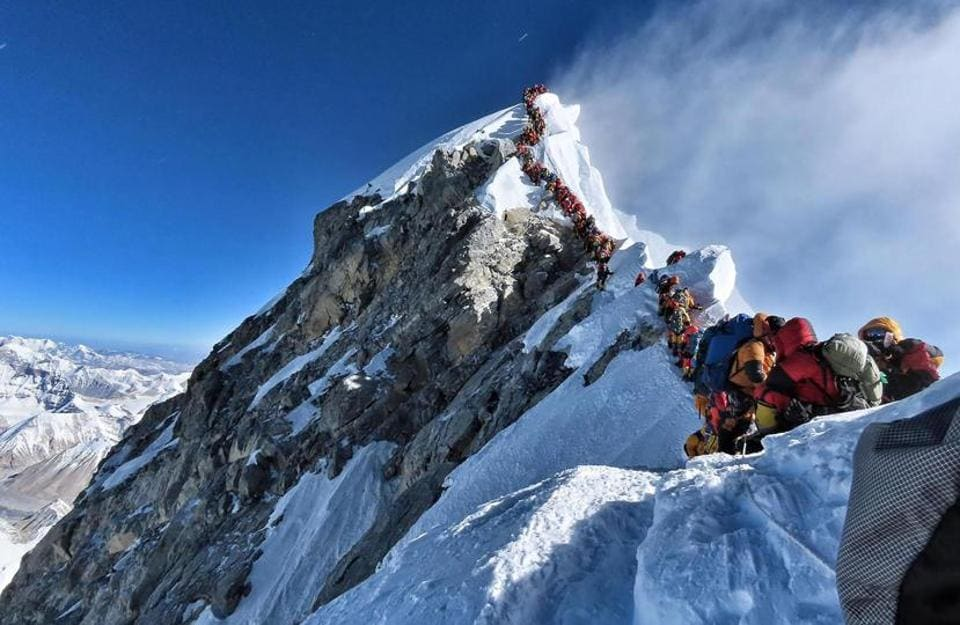 The image of hundreds of humans jammed in a queue, waiting to summit Mount Everest, is to me an image of heartbreak.