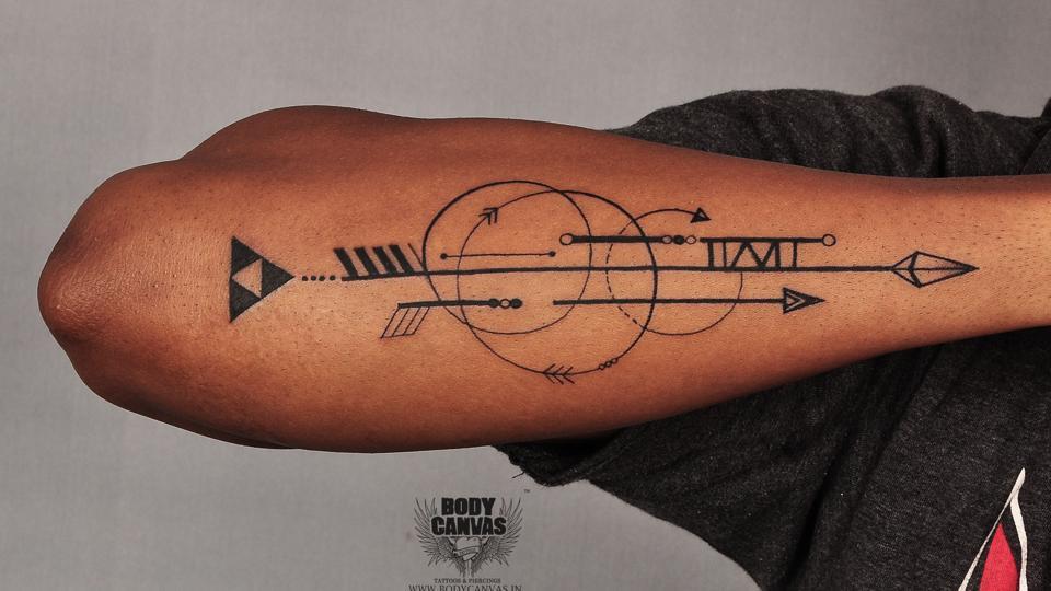 Baseball tattoos and piercing