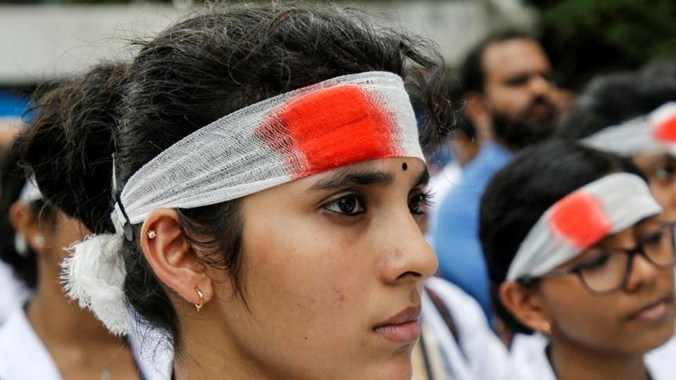 Medical students wearing mock bandages participate in a protest called by Indian Medical Association (IMA), during a nationwide doctors strike in Kochi. A 10-member committee to examine the feasibility of enacting a central law to stop violence against doctors across states by the Union Cabinet.