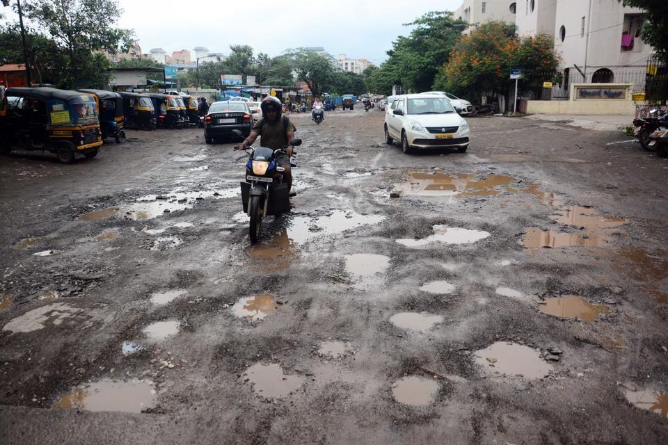 Pune,raining,potholes
