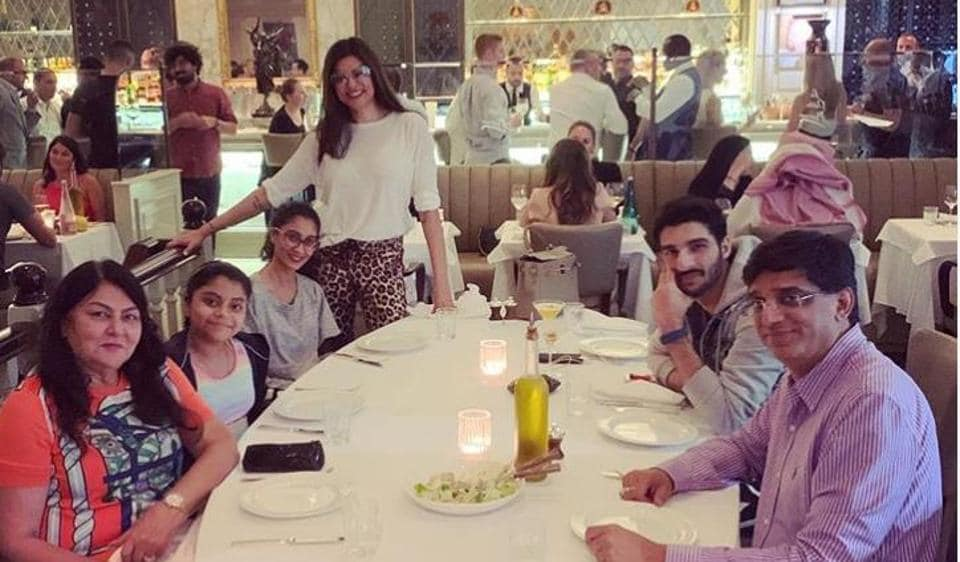 Sushmita Sen poses with her family at a dinner.