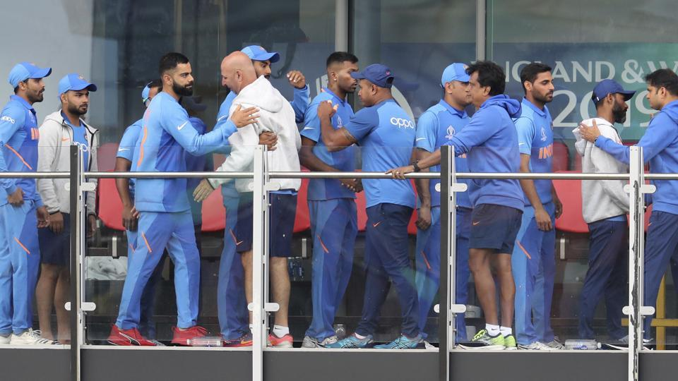 Indian cricketers greet each other after their team lost the Cricket World Cup semifinal.
