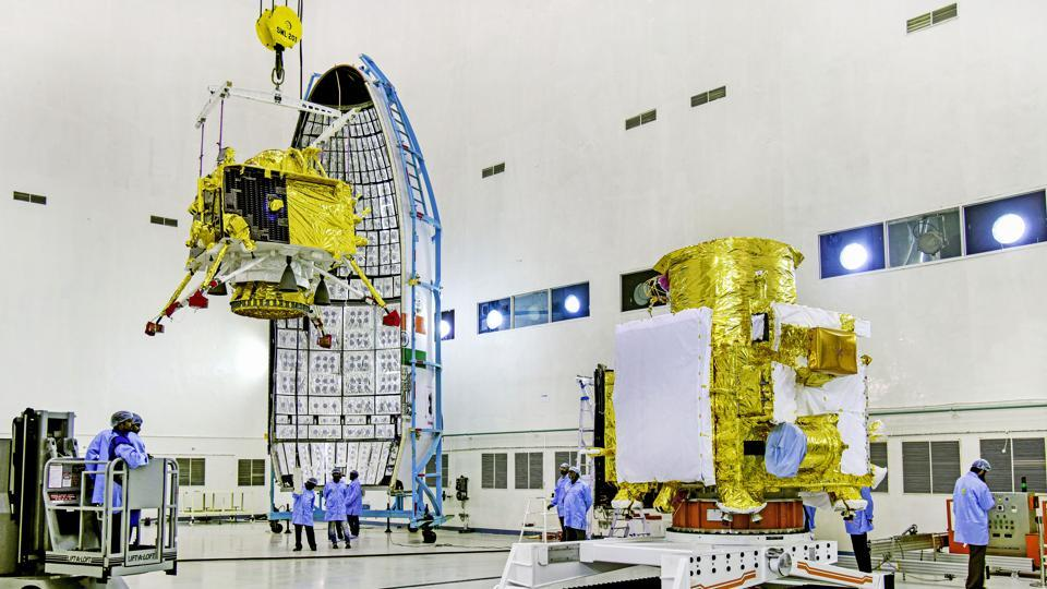In this picture released by ISRO, officials carry out the hoisting of the Vikram Lander during the integration of Chandrayaan-2, at the launch center in Sriharikota.