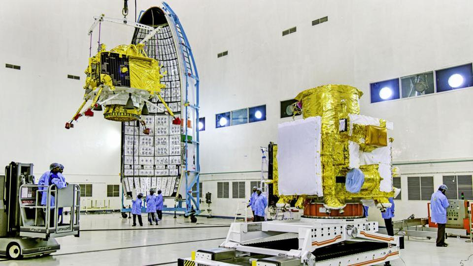 ISRO officials carry out the hoisting of the Vikram Lander during the integration of Chandrayaan-2, at the launch centre in Sriharikota. This launch scheduled on July 15 will be ISRO's second mission to the moon. After the launch, it will take 16 days to raise the orbit and then five days to reach the moon's orbit. (ISRO / PTI)