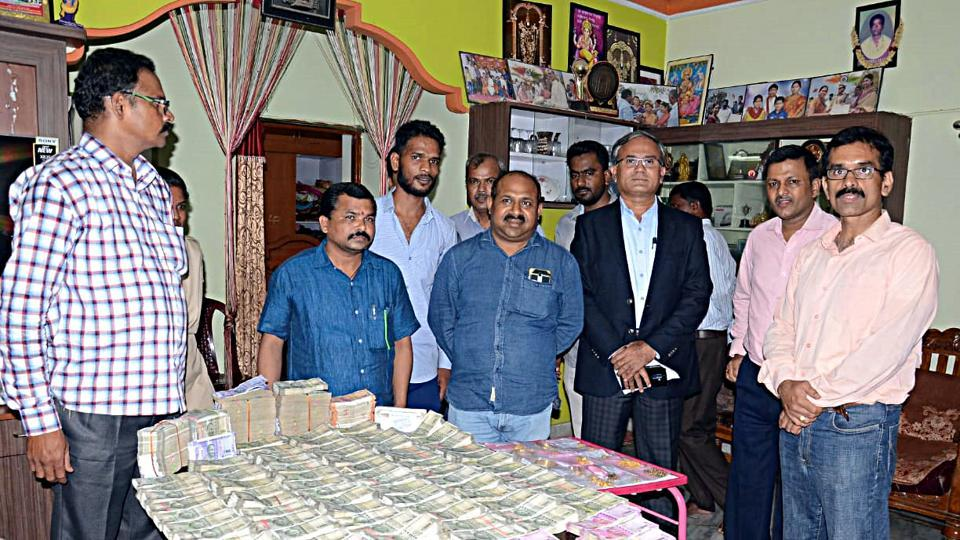 Telangana: The Anti-Corruption Bureau (ACB) sleuths conducted searches in the house of V Lavanya, Tahsildar of Keshampet at Ranga Reddy district, in Hyderabad on Wednesday. Rs 93.5 lakh cash and 400 grams gold have been recovered. (ANI Photo)
