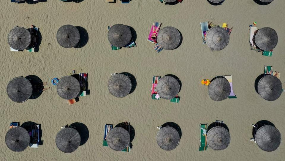 Parasols seen on a beach of the Adriatic Sea in Durres, as heatwave sweeps through Europe. Temperatures rose to 39 degrees Celsius in Albania. (Gent Shkullaku / AFP)