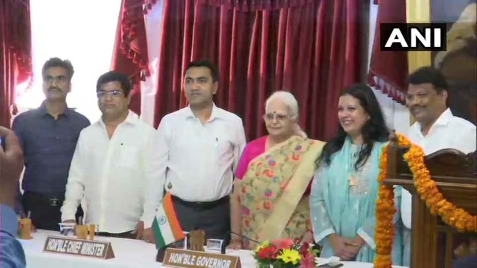 Goa Chief Minister Pramod Sawant and Governor Mridula Sinha  with the four new ministers after they were sworn in on Saturday.