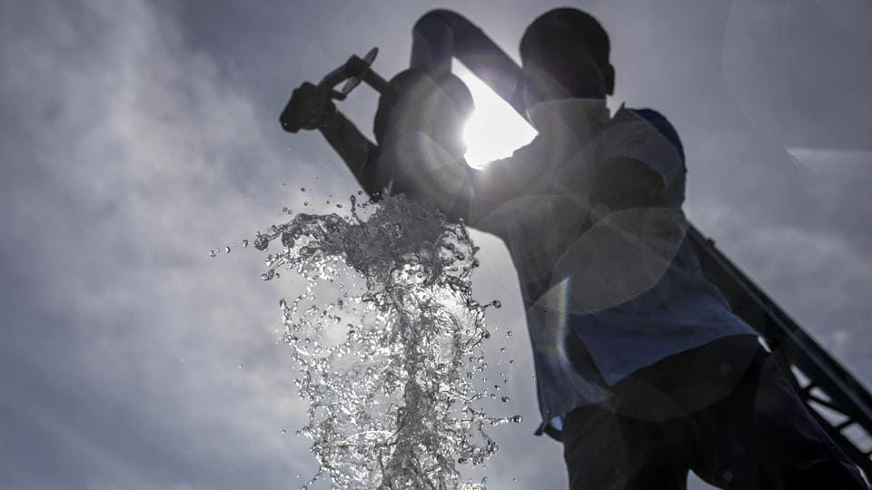 Water pours from a pipe into a tanker at a government-run water-filling station in Chennai. Failed rains last year and delays in this year's annual monsoon have left nearly half of India facing drought-like conditions, according to the South Asia Drought Monitor. This is forcing many hospitals to buy water for running their operations. (Dhiraj Singh / Bloomberg)