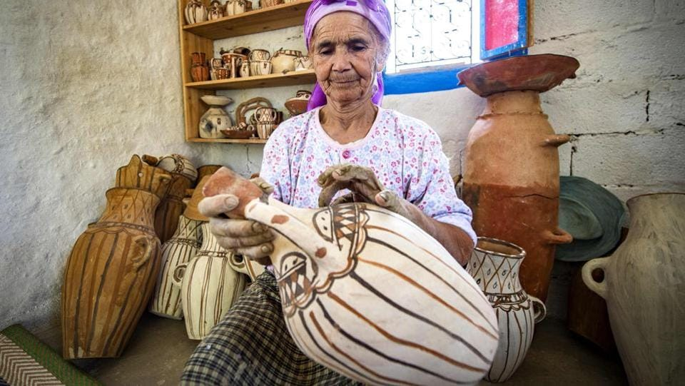 Moroccan potter Aicha Tabiz, also known as Mama Aicha, holds one of her works near the village of Ourtzagh in the foothills of the Rif Mountains. Beautiful handcrafted pottery made by Aicha rarely sells in Morocco anymore, but thanks to social media her ancient techniques are drawing students from around the world to the foothills of the Rif. (Fadel Senna / AFP)