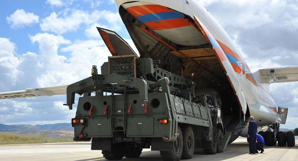A handout photograph taken and released on July 12, 2019, by the Turkish Defence Ministry shows a Russian military cargo plane carrying S-400 missile defence system from Russia to the Murted military airbase (also known as Akincilar millitary airbase), in Ankara.