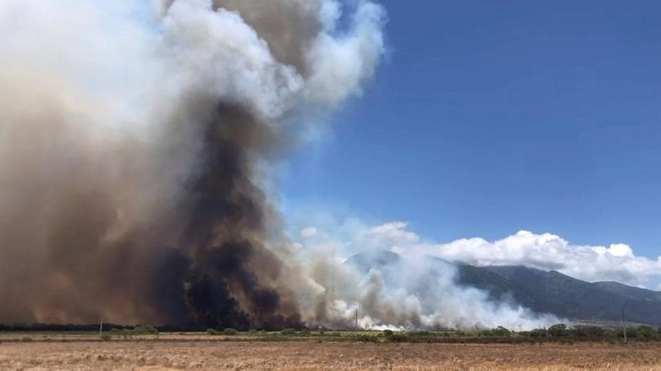 A wildfire is seen on the island of Maui, Hawaii, U.S., July 11, 2019 in this video grab taken from social media, July 12, 2019. John Sandbach Photography/Instagram@sandbachspics via REUTERS