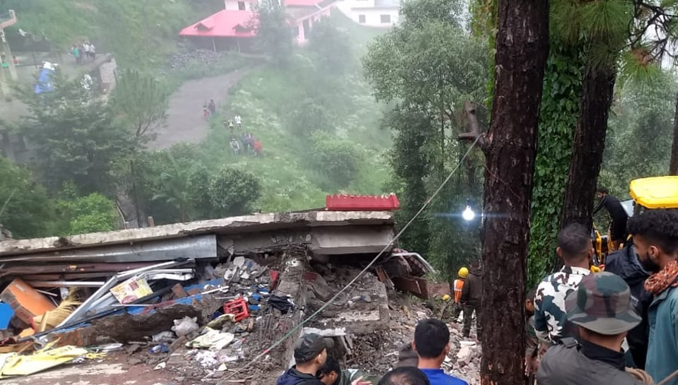 Two people died while 20 others were injured after a three-storey building caved in post heavy rains near Kumarhatti in Himachal Pradesh's Solan district.