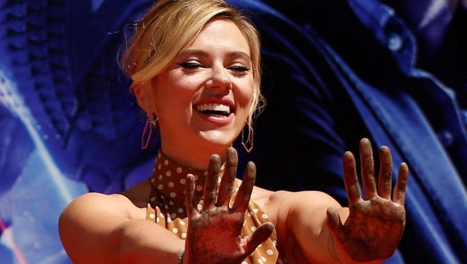 Actor Scarlett Johansson shows her hands after placing them in cement at a ceremony at the TCL Chinese Theatre in Hollywood.