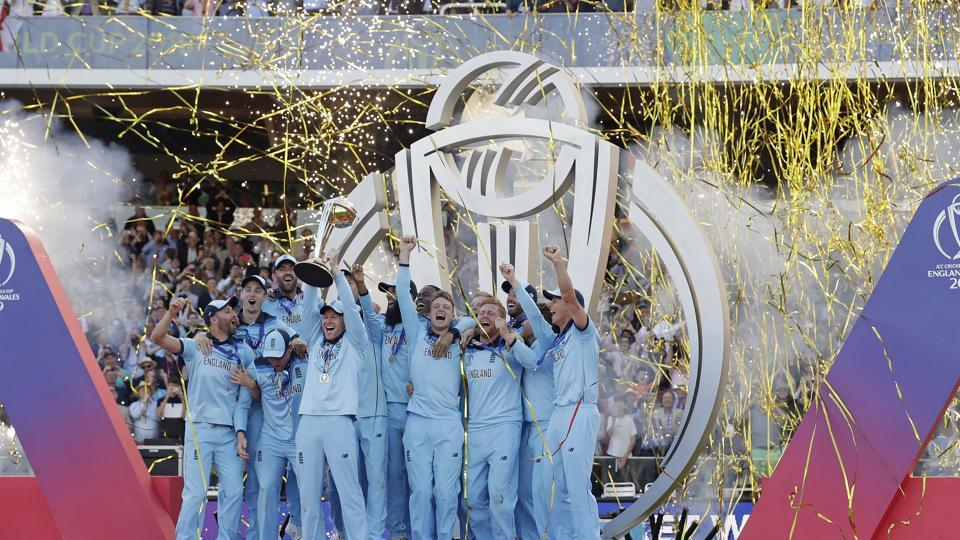 England's captain Eoin Morgan raises the trophy after winning the Cricket World Cup final. (AP)