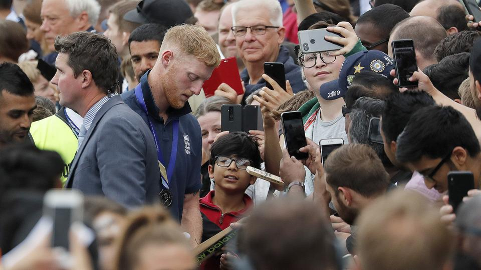 England's Ben Stokes signs autographs at the Oval in London.