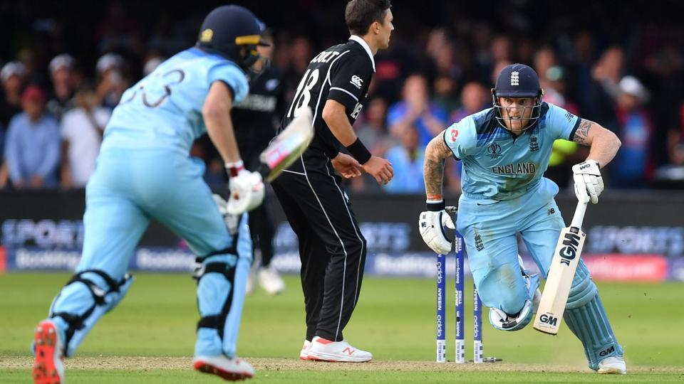 England's Ben Stokes (R) and England's Jos Buttler (L) add runs in the 'super over'.