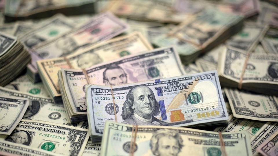 US Dollar banknotes are seen in this photo illustration. (Representative Image)