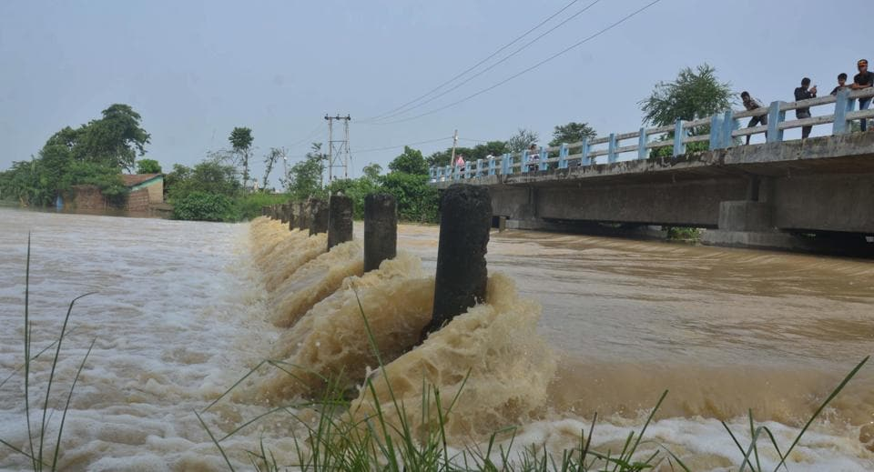 Flood Fury following heavy monsoon rains at Katra block in Muzaffarpur on Monday. Around 6.93 million people have been affected as thousands of villages have been marooned.