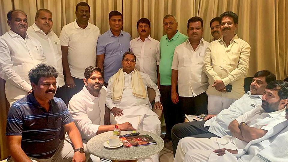 The 14 rebel Karnataka MLAs, staying in Mumbai's luxury hotel, have written to state police over an alleged 'threat' from senior Karnataka and Maharashtra Congress leaders.