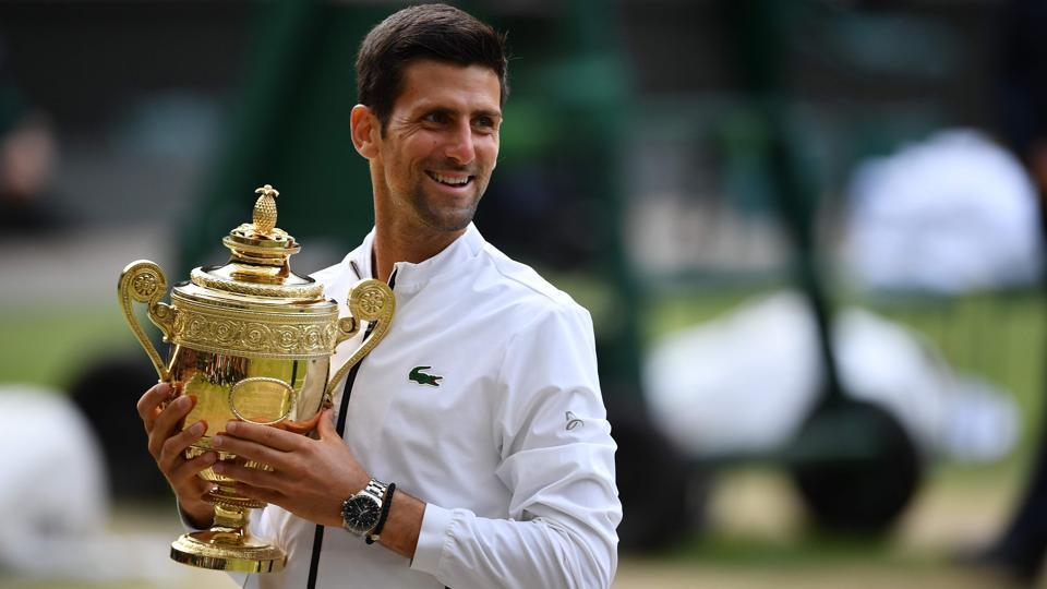Novak Djokovic holds the winner's trophy during the presentation.