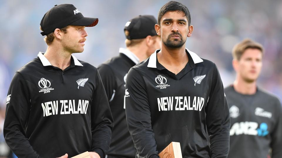 New Zealand's Lockie Ferguson (L) and New Zealand's Ish Sodhi (R) react to their defeat.