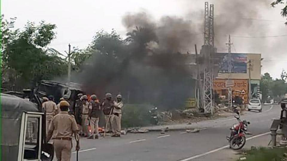 Angry over the murder of a man, members of the Patel community blocked  a road in Udaipur district and pelted police personnel with stones and torched their vehicles, Monday, Ju;y 15, 2019.