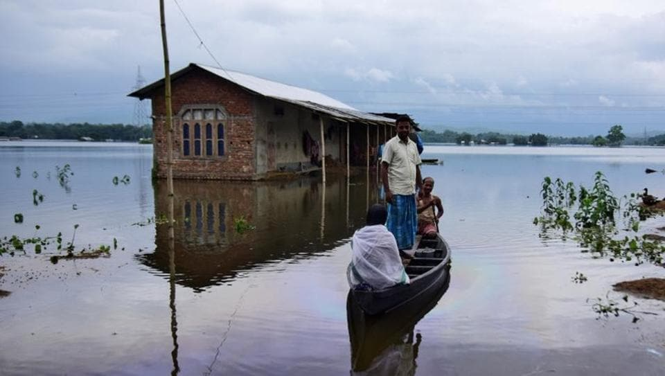 Villagers are transported on a boat towards a safer place at a flooded village in Nagaon district, in the northeastern state of Assam, India July 15, 2019.