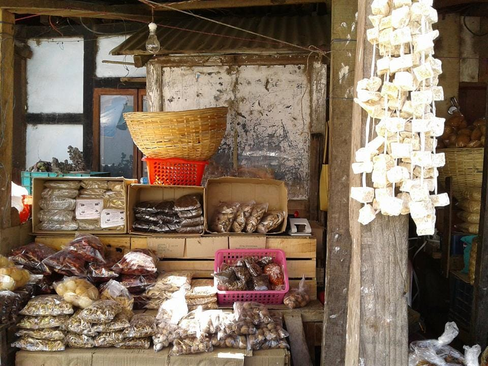Fermented cheese and dried mushrooms at a roadside stall in Bhutan.