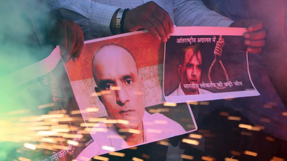 Ahmedabad, India – May 18, 2017: Indians holds posters of Indian naval officer Kulbhushan Jadhav and lights fire crackers as they celebrate the International Court of Justice order on Jadhav, in Ahmadabad, India, Thursday, May 18, 2017. (Photo by )