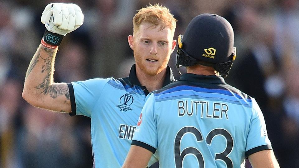 England's Jos Buttler (R) and England's Ben Stokes react during the super over.