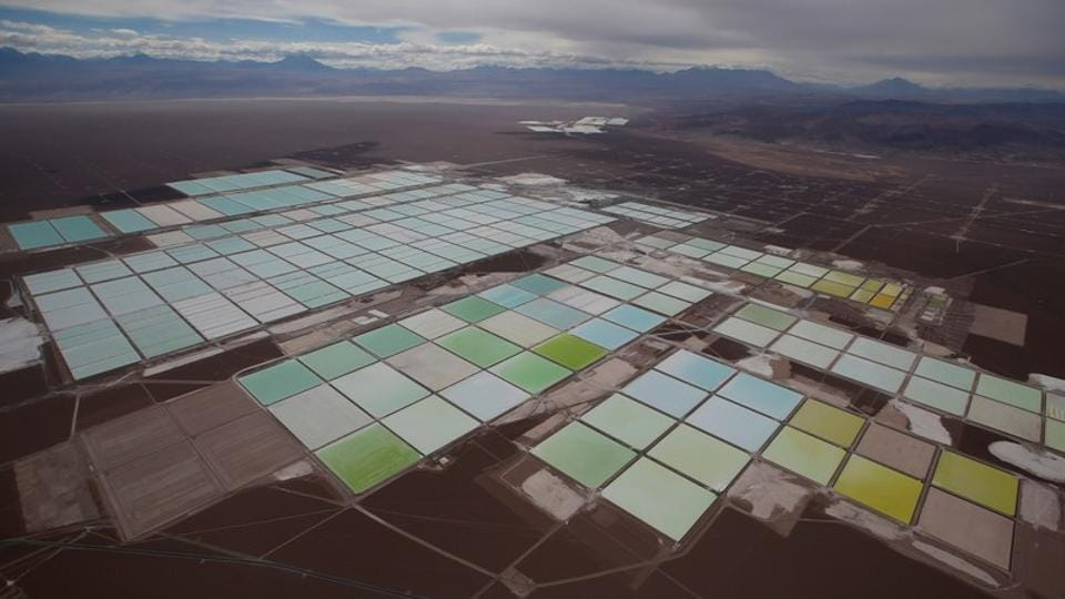 FILE PHOTO: An aerial view shows the brine pools of SQM lithium mine on the Atacama salt flat in the Atacama desert of northern Chile.