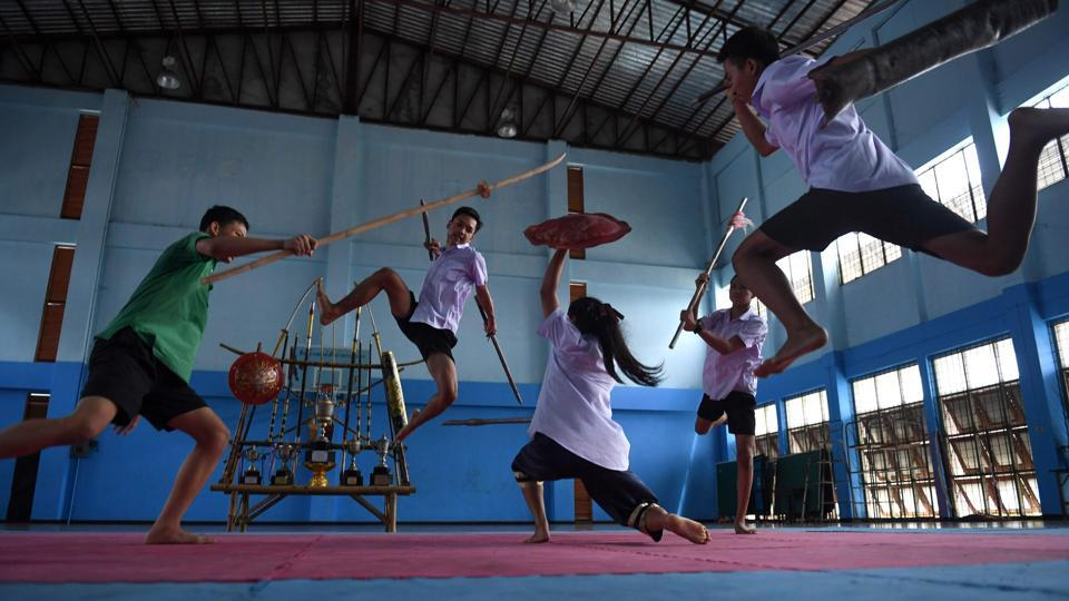 Students practise Krabi Krabong, a Thai martial art, at the Thonburee Woratapeepalarak school in Thonburi, on the outskirts of Bangkok, Thailand. The fighters are part of a growing group of students at the school mastering the country's neglected swordfighting tradition. (Lillian Suwanrumpha / AFP)