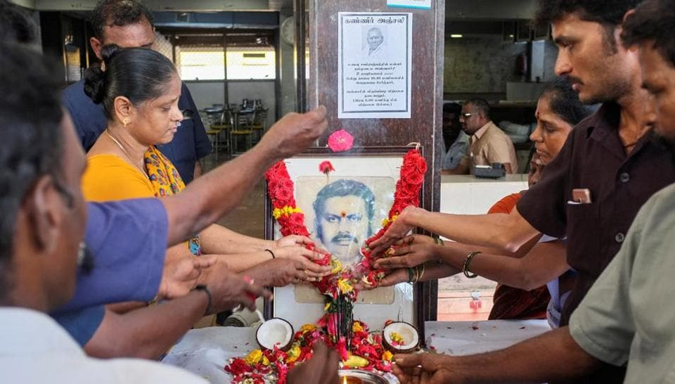 Employees pay tribute in front of a portrait of P. Rajagopal, founder of Saravana Bhavan. P Rajagopal (72) died in a Chennai hospital today, two days after he was shifted from jail where he was serving life term for murdering his employee. The Madras High Court had on Tuesday allowed Rajagopal to seek treatment at a private hospital for several health issues following which he was shifted from government Stanley Hospital where he was being treated in the prison ward.  (P. Ravikumar / REUTERS)