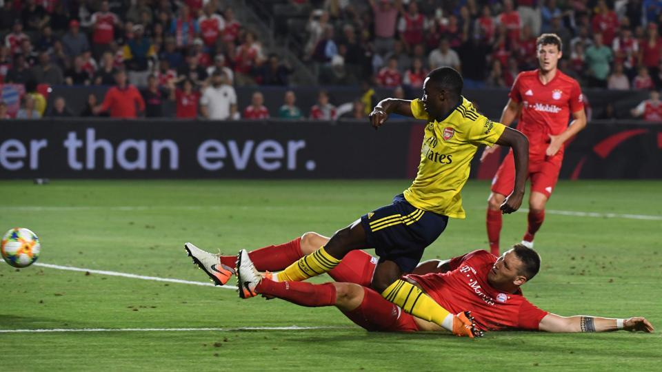 Forward Eddie Nketiah of Arsenal (L) is tackled by Niklas Sule of Bayern Munich during their International Champions Cup game at the Dignity Health Stadium in Carson, California on July 17, 2019. - Arsenal went on to win 2-1. (Photo by Mark RALSTON / AFP)