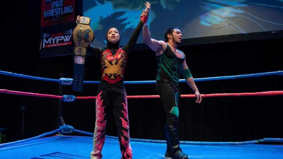 Phoenix holds the Wrestlecon championship belt after winning a match against male opponents. While it is growing in popularity, wrestling remains relatively small in the Southeast Asian country. There are about 30 fighters and matches take place every two to three months in front of a few hundred supporters. Diana is one of just two women wrestlers.  (Mohd Rasfan / AFP)