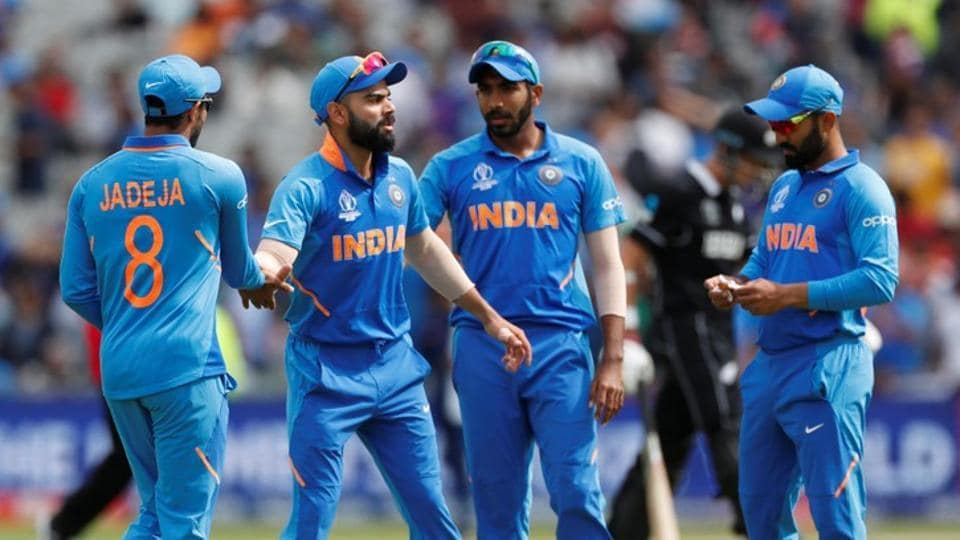 Cricket - ICC Cricket World Cup Semi Final - India v New Zealand - Old Trafford, Manchester, Britain - July 10, 2019 India's Virat Kohli and team mates after New Zealand's innings