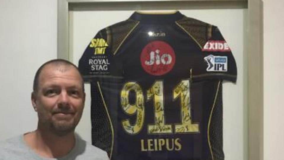 Andrew Leipus poses with the KKR shirt.