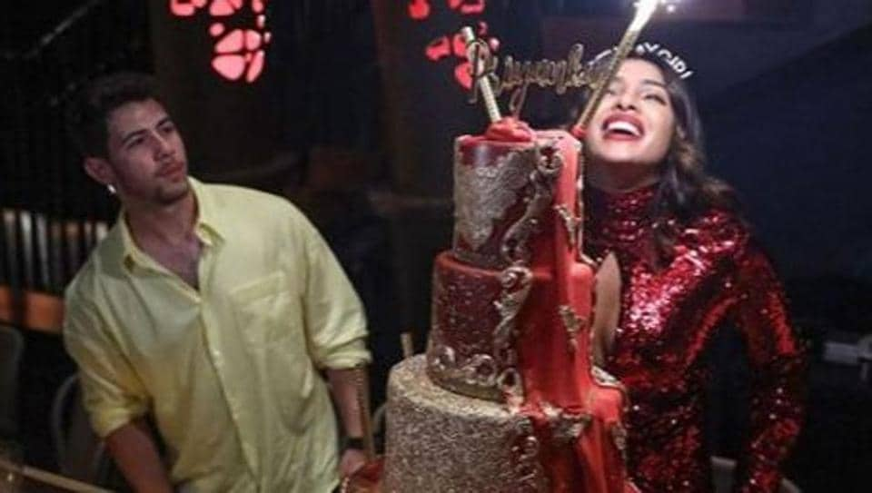 Priyanka Chopra's massive, five-tier birthday cake is almost as tall as Nick Jonas. See pics