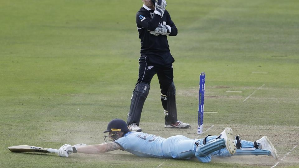 England's Ben Stokes dives in to make his ground and get a 6 from overthrows.