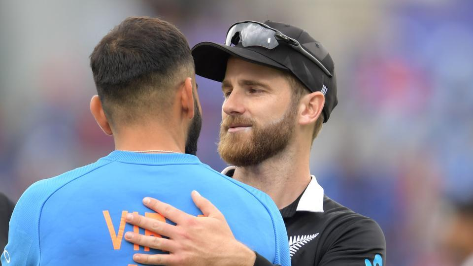 New Zealand captain Kane Williamson (R) greets India's captain Virat Kohli after the 2019 Cricket World Cup first semi-final between New Zealand and India at Old Trafford.