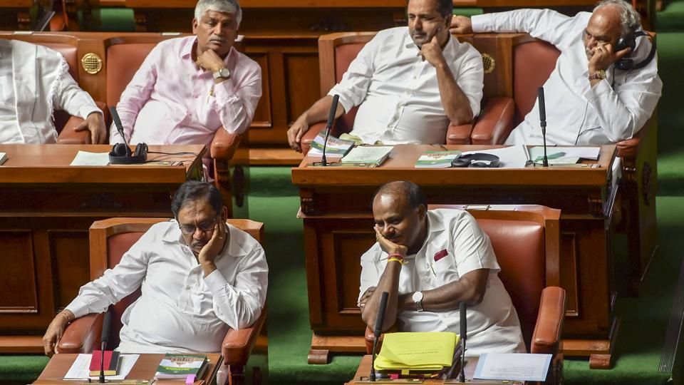 Karnataka Chief Minister H D Kumaraswamy with his deputy G Parameshwara during the assembly session at Vidhana Soudha in Bengaluru